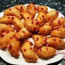 Shahi Puli Pitha / Glazed Fried Coconut Stuffed Dumplings